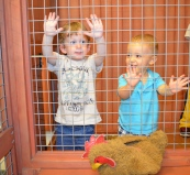 August and Owen in the chicken coupe.